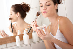 Body Care - Young Woman Apply Powder Stock Photography