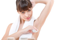 Body care: Young woman applying deodorant Stock Photos