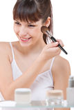 Body care: Young woman applying powder with brush Stock Photos