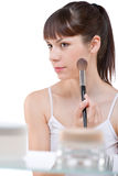 Body care: Young woman applying powder with brush Stock Photo