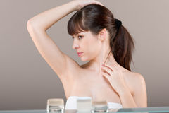 Body care: Young woman in bathroom Royalty Free Stock Images