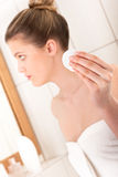 Body care - Young woman clean her face Royalty Free Stock Image