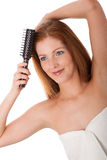Body care - Young woman comb out hair. On white background Stock Image