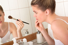Body care - Young woman doing make-up Stock Image