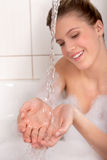 Body care - Young woman enjoy bath Royalty Free Stock Image