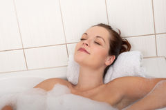 Body care - Young woman enjoy bath Royalty Free Stock Photography