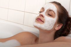 Body care - Young woman with facial mask Stock Photography