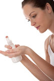 Body care - Young woman with lotion Stock Image