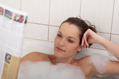 Body care - Young woman with magazine Stock Photo