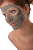 Body care - Young woman with mud mask Royalty Free Stock Photo