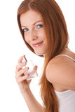 Body care - Young woman with perfume Royalty Free Stock Photos