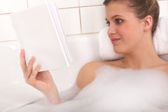 Body care - Young woman read book Stock Photography