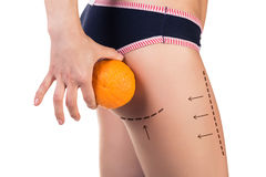 Body with cellulitis and orange fruit. On white background, side view Royalty Free Stock Images