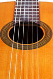 Body of classical acoustic guitar close up Royalty Free Stock Images
