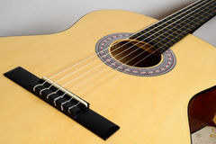 Body classical guitar with yellow deck isolated on white background Royalty Free Stock Photos