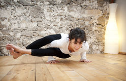 Body control and Yoga. Young woman doing yoga indoors Royalty Free Stock Photos