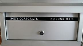 Body corporate mailbox with lock in apartment building stock photos