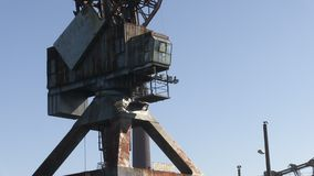 Body of a crane shot. A medium shot of a body of a crane and sky stock video footage