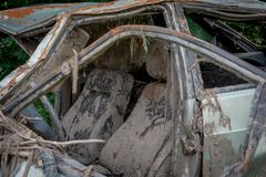 The body of a crashed car drowned in mud. Stands on the grass royalty free stock photos
