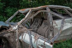 The body of a crashed car drowned in mud. Stands on the grass stock photography