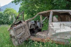 The body of a crashed car drowned in mud. Stands on the grass royalty free stock photography