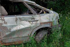 The body of a crashed car drowned in mud. Stands on the grass royalty free stock images