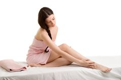 Body creme application. Young woman applying body creme - health and beauty Royalty Free Stock Photography