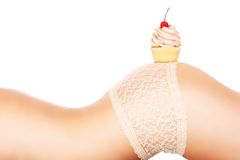 Body and cupcake Royalty Free Stock Photos