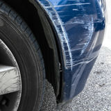 Body damage. Accident damage to the front side of a blue car Royalty Free Stock Photography