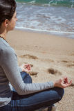 Body detail of a beautiful girl in a meditation on the beach.  Stock Photo