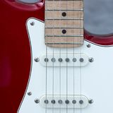 Body of electric guitar with snares and pickups. Body of red electric guitar with snares and pickups Stock Photo