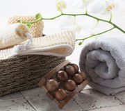 Body exfoliation with femininity. Spa and beauty concept - accessories made of natural materials, loofah and massage tool with cotton towel background for Stock Images