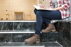 Body of female Student sitting on Stairs in University Campus Royalty Free Stock Image