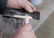 Body filler preparing for car repare. Stock Image