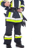 Body of a fireman showing his uniform and gear. Body of a fireman showing his uniform with high visibility neon trim and his equipment including his safety Royalty Free Stock Images