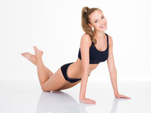 Body Fit Smiling Woman Exercising on Floor Stock Photography