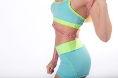 Body of fitness woman with measuring tape on waist Stock Photos