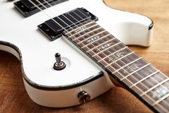 Body and fretboard of modern electric guitar. royalty free stock photography