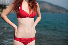 Body of the girl in a bathing suit near the sea. Travel body of the girl in a bathing suit near the sea Royalty Free Stock Photos