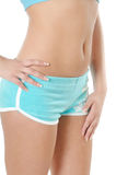 Body of girl in blue shorts Stock Photography