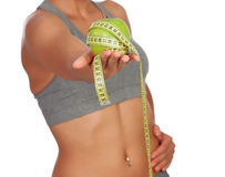 Body girl taking an apple with a measuring tape Stock Photo
