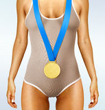 Body with gold medal. Part of beautiful woman body wearing gold medal Royalty Free Stock Photography