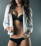 Body of gorgeous sexy woman in black lingerie and white jacket Stock Images