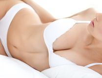 Body of a halfnaked woman in white bra Stock Image