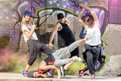 Body jam dancers cheerfully trains outside. Group of body jam dancers cheerfully trains in front of colorful wall outside Royalty Free Stock Image