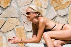 Body language. Passive posed attractive female in black bikini Royalty Free Stock Images