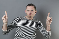 Body language concept for frowning 40s man showing something Stock Photography