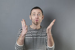 Body language concept for fun 40s man smiling Royalty Free Stock Images