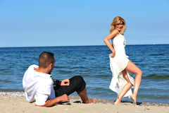 Body language - honeymooners. Bride tempting her man with sensual body language stock photos