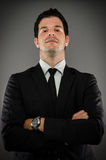 Body Language. Image of a young business professional with his arms crossed Stock Photo